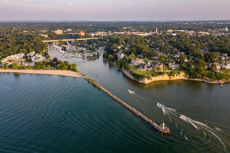 Rocky River, Oh Insurance - Aerial View of Rocky River, Ohio, With Boats Passing on the Blue Water and Green Land Stretching Beyond